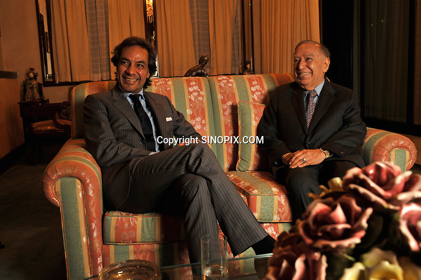 Dr Hari Harilela, 87, poses with son and heir apparent Dr Aron Harilela, 37,  in the family lounge of their Kowloon Tong residence in Hong Kong 18th October 2009. Hari is the director of the Harilela group.  The Harilela's are one of Hong Kong'sand Asia's best known and and most successful family businesses.<br /> <br /> Photo by Richard Jones
