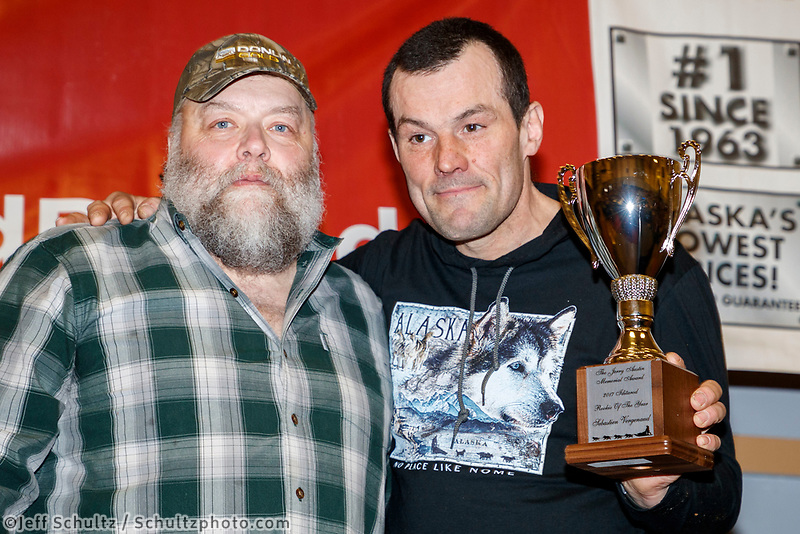 The Jerry Austin Memorial Rookie of the Year<br /> Award is presented on behalf of the Austin family by race marshal Mark Nordman to Sebastien Vergnaud<br />  at the Nome Musher's Award Banquet during the 2017 Iditarod on Sunday March 19, 2017.<br /> <br /> Photo by Jeff Schultz/SchultzPhoto.com  (C) 2017  ALL RIGHTS RESERVED