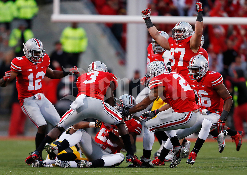 Ohio State Buckeyes defense celebrates after an interception by Ohio State Buckeyes defensive back Tyvis Powell (23) in the fourth quarter the NCAA football game between the Ohio State Buckeyes and the Iowa Hawkeyes at Ohio Stadium in Columbus, Saturday afternoon, October 19, 2013. The Ohio State Buckeyes defeated the Iowa Hawkeyes 34 - 24.  (The Columbus Dispatch / Eamon Queeney)