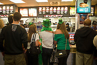 Revelers order food in a McDonald's restaurant in Times Square in New York on Wednesday, March 17, 2010 after the St. Patrick's Day parade. (© Richard B. Levine)