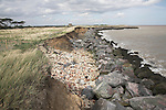 A wall rock armour composed of large igneous boulders imported from Scandinavia are failing to stop continued coastal erosion of the soft, sandy cliffs at East Lane, Bawdsey, Suffolk, England.