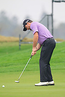 Graeme McDowell (NIR) putts on the 1st green during Thursday's Round 1 of the 2014 BMW Masters held at Lake Malaren, Shanghai, China 30th October 2014.<br /> Picture: Eoin Clarke www.golffile.ie