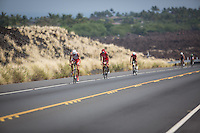 A pack of elite men climbing a hill on the Queen K on the bike at the 2013 Ironman World Championship in Kailua-Kona, Hawaii on October 12, 2013.