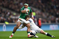 Bundee Aki of Ireland is tackled by Elliot Daly of England. Natwest 6 Nations match between England and Ireland on March 17, 2018 at Twickenham Stadium in London, England. Photo by: Patrick Khachfe / Onside Images