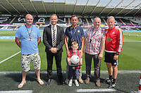 Swansea club ambassator Lee Trundle (2nd L) and coach Alan Curtis (R) with match ball sponsors during the Swansea City FC v Manchester City Premier League game at the Liberty Stadium, Swansea, Wales, UK, Sunday 15 May 2016