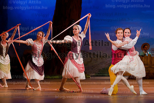 Dancers Zoltan Olah (left) as Colas and Adrienn Pap (right) as Lise in the dance piece La Fille Mal Gardee or The Wayward Daughter Choreographed by Sir Frederick Ashton presented by the Hungarian National Ballet Company in Hungary State Opera House,  Budapest, Hungary, Tuesday, 23. November 2010. ATTILA VOLGYI