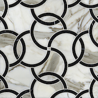 Coco, a stone water jet mosaic, shown in Nero Marquina and Calacatta Tia, is part of the Ann Sacks Beau Monde collection sold exclusively at www.annsacks.com