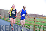 Arthur Fitzgerald, Farranfore Maine Valley and John Barrett, Gneeveguilla AC, pictured leading the Gneeveguilla Winter Series 5k run in Killarney on Saturday morning..