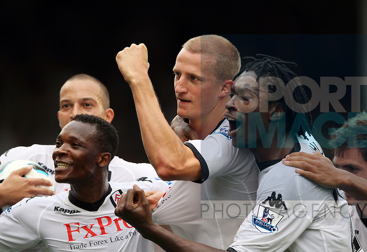 Fulham's Brede Hangeland celebrates his late goal