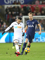 Martin Olsson of Swansea City  plays a pass under pressure from Harry Kane of Spurs during the Premier League match between Swansea City and Tottenham Hotspur at the Liberty Stadium, Swansea, Wales on 2 January 2018. Photo by Mark Hawkins / PRiME Media Images.
