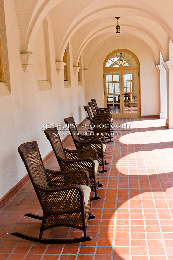 Wicker rocking chairs on the porch of a spa on Bath House Row, , Hot Springs National Park, Hot Springs, Arkansas, USA.