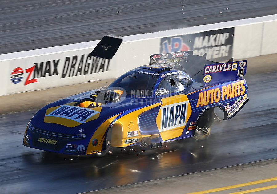 Sep 19, 2015; Concord, NC, USA; NHRA funny car driver Ron Capps explodes an engine sending the burst panel flying during qualifying for the Carolina Nationals at zMax Dragway. Mandatory Credit: Mark J. Rebilas-USA TODAY Sports