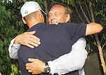 Martin Kaymer hugs his father after he finished his final round of the Dubai World Championship on the Earth Course at the Jumeirah Golf Estate, Dubai..Picture Fran Caffrey/www.golffile.ie.