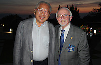 NWA Democrat-Gazette/CARIN SCHOPPMEYER Dr. Tony Hui (left) and Dick Trammel, both past Gentleman of Distinction honorees, visit the the VIP reception.