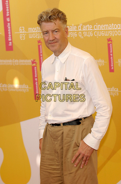"DAVID LYNCH.Photocall for ""Inland Empire"".5th September 2006.63rd Venice International Film Festival, Italy.Ref: KRA.half length white shirt.www.capitalpictures.com.sales@capitalpictures.com.©Persun/Capital Pictures"