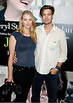 "WESTWOOD, CA. - July 27: Yvonne Strahovski and Tim Loden arrive at the Los Angeles screening  of ""Julie & Julia"" at the Mann Village Theatre on July 27, 2009 in Westwood, California."