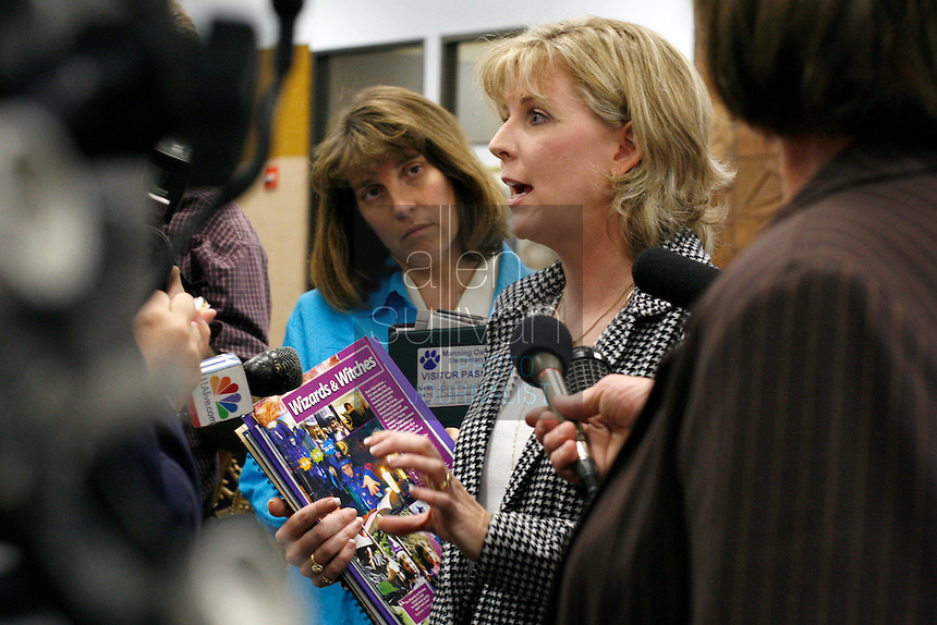 Laura Mallory, a mother from Loganville, Ga., speaks to the media at the Georgia Board of Education after a hearing in her effort to have &quot;Harry Potter&quot; books removed from the shelves in Gwinnett County public schools. Mallory argued that the books &quot;promote the particular religion of witchcraft&quot; and that children practice spells from the books. &quot;You would think we'd want to do everything we can to remove evil from our schools,&quot; she said. Mallory said that she has never read in full any of the &quot;Harry Potter&quot; books. Hearing officer L.O. Buckland will make a recommendation to the State Board of Education, but he did not say when that will occur.<br />