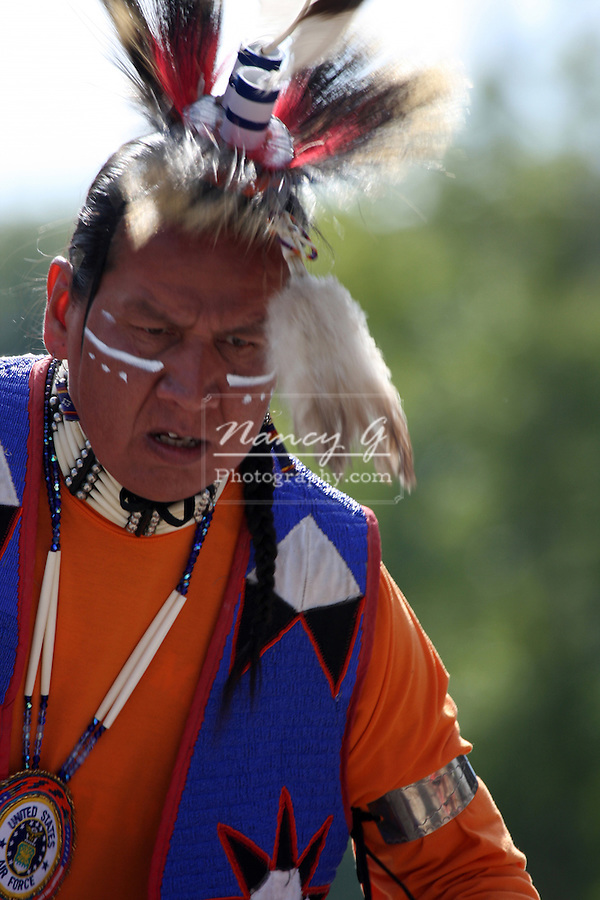 A Native American Indian man dancing in a fancy outfit at a Pow Wow at the Milwaukee Lakefront Indian Summer Festival, Wisconsin
