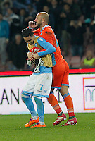 Pepe Reina and  Jose Callejon celebrate at the end of Italian Serie A soccer match between SSC Napoli and Juventus FC   at San Paolo stadium in Naples, March 30 , 2014