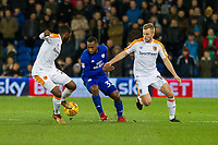 Junior Hoilett of Cardiff City gets between Sebastian Larsson and Fikayo Tomori of Hull City during the Sky Bet Championship match between Cardiff City and Hull City at the Cardiff City Stadium, Cardiff, Wales on 16 December 2017. Photo by Mark  Hawkins / PRiME Media Images.