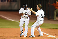 Lakeland Flying Tigers designated hitter Lance Durham (32) celebrates a walk off hit with pitcher Guido Knudson (51) during a game against the Brevard County Manatees on April 10, 2014 at Joker Marchant Stadium in Lakeland, Florida.  Lakeland defeated Brevard County 6-5.  (Mike Janes/Four Seam Images)
