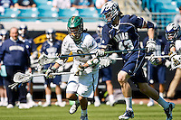 February 20, 2011:   Georgetown Hoyas defender Barney Ehrmann (43) tries to block Jacksonville Dolphins attack Max Gurowski (8) during lacrosse action between the Georgetown Hoyas and Jacksonville Dolphins during the Moe's Southwest SunShine Classic played at EverBank Field in Jacksonville, Florida.  Georgetown defeated Jacksonville 14-11.