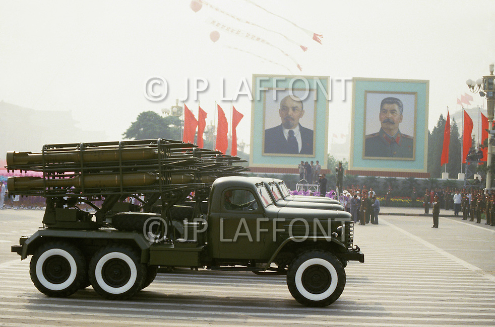 Beijing, China. October 1st, 1984. This huge parade is for the celebration of the 35th Anniversary of the Chinesse Revolution. Trucks with long range rockets in front of the Communist founders, Lenin and Stalin.