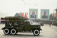 Beijing, China. October 1st, 1984. This huge parade is for the celebration of the 35th Anniversary of the Chinese Revolution. Trucks with long range rockets in front of the Communist founders, Lenin and Stalin.