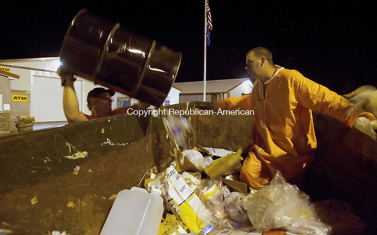 BETHLEHEM, CT -  - 10 SEPTEMBER 2005 -091005JS02--[12:12 am] Brian Simmons of Middletown, NY, left and Eugene Grimmig of Orange County, NY, right, pick up trash at the end of the frist day of the Bethlehem Fair. The workers empty more than 150 trash barrels a day. <br /> Jim Shannon / Republican-American<br /> Brian Simmons; Eugene Grimmig, Bethlehem are CQ
