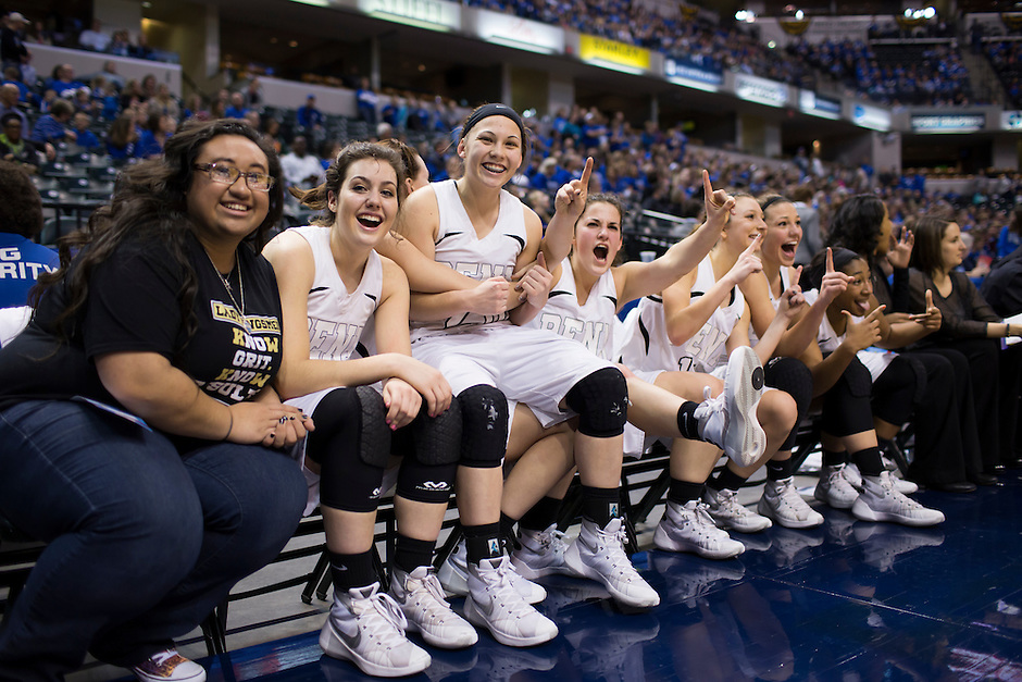 Penn starters celebrate on the bench in the closing seconds of a 68-48 win against Columbus North in the IHSAA Class 4A Girls Basketball State Championship Game on Saturday, Feb. 27, 2016, at Bankers Life Fieldhouse in Indianapolis.