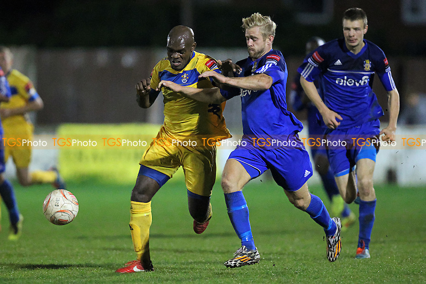 Greg Akpele of Romford and Paul Preston of Aveley during Aveley vs Romford, Ryman League Divison 1 North Football at the Mill Field, Aveley, England on 21/09/2015