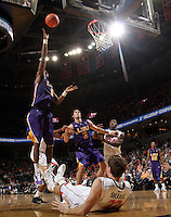 Jan. 2, 2011; Charlottesville, VA, USA; LSU Tigers forward Malcolm White (5) shoots over Virginia Cavaliers forward Will Sherrill (22) during the game at the John Paul Jones Arena. Virginia won 64-50. Mandatory Credit: Andrew Shurtleff