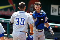 Jeremy Lucas (32) of the Indiana State Sycamores celebrates with Jon Hedges after he hit a home run during a game against the Evansville Purple Aces in the 2012 Missouri Valley Conference Championship Tournament at Hammons Field on May 23, 2012 in Springfield, Missouri. (David Welker/Four Seam Images)