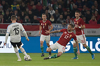 Federico Valverde (L) of Uruguay and Roland Varga (2nd R) of Hungary fight for the ball during the inauguration match of the newly reconstructed Ferenc Puskas Stadium between Hungary and Uruguay in Budapest, Hungary on Nov. 15, 2019. ATTILA VOLGYI