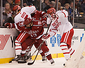 Chad Krys (BU - 5), Nathan Krusko (Harvard - 13), Charlie McAvoy (BU - 7) - The Harvard University Crimson defeated the Boston University Terriers 6-3 (EN) to win the 2017 Beanpot on Monday, February 13, 2017, at TD Garden in Boston, Massachusetts.