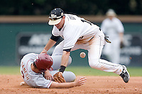 Ohmed Danesh (2) of the Florida State Seminoles slides into second base as Andy Goff (12) of the Wake Forest Demon Deacons can't handle the throw at Gene Hooks Stadium on the campus of Wake Forest University in Winston-Salem, NC, Friday, March 28, 2008.