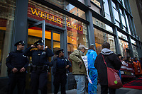 NEW YORK, NY - APRIL 5: NYPD officers exit the Wells Fargo bank as Indigenous peoples and Activists begin the overnight camp out in front of the branch on April 5, 2017 in Soho, New York City. Activists are looking to drive mayor Bill De Blasio attention to divest founds from banks like Wells Fargo &amp; Company which has caused controversy for their investment in the Dakota Access Pipeline (DAPL)&mdash;a project that will be constructed through land owned by the Standing Rock Indian Reservation and covers land stretching from North Dakota to central Illinois. Photo by VIEWpress/Eduardo MunozAlvarez<br /> <br /> divest