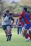 Mark Selwyn pushes off Cody Martins attempted tackle. Counties Manukau Premier Rugby game between Ardmore Marist  and Manurewa played at Bruce Pulman Park Papakura on May 14th 2011. Ardmore Marist won 48 - 10 after leading 29 - 3 at halftime.