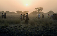 At the end of the day's competition crowds walk back to their villages during the Twic Olympics in Wunrok, Southern Sudan.