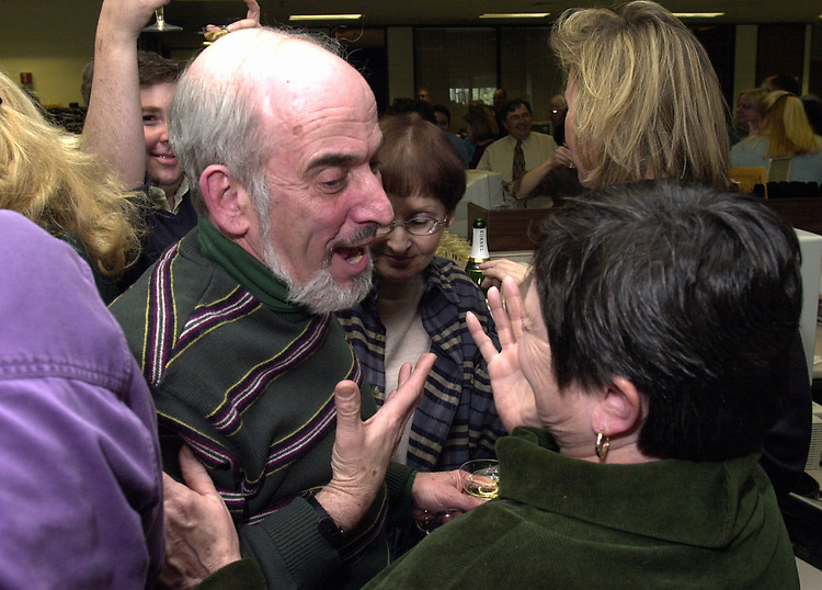 Stan Wolfson and Alice Norkett at champagne get together of Newsday staff in the City room to toast the departure of colleagues on Friday March 1, 2002. (Photo by Jim Peppler).