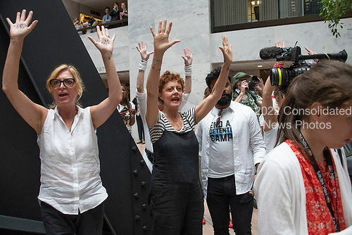 "Actress Susan Sarandon, center, joins the ""Women's March in Civil Disobedience to End Family Detention"" in the atrium of the Hart Senate Office Building in Washington, DC on Thursday, June 28, 2018.  <br /> Credit: Ron Sachs / CNP<br /> (RESTRICTION: NO New York or New Jersey Newspapers or newspapers within a 75 mile radius of New York City)"
