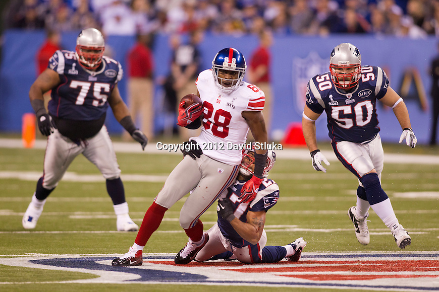 New York Giants wide receiver Hakeem Nicks (88) is tackled by New England Patriots defensive back Antwaun Molden (27) during the NFL Super Bowl XLVI football game on Sunday, Feb. 5, 2012, in Indianapolis. The Giants won 21-17 (AP Photo/David Stluka)...