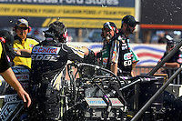 Mar 28, 2014; Las Vegas, NV, USA; Debris flies as the blower belt on the dragster of NHRA top fuel driver Brittany Force shreds during qualifying for the Summitracing.com Nationals at The Strip at Las Vegas Motor Speedway. Mandatory Credit: Mark J. Rebilas-USA TODAY Sports