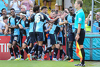 Aaron Pierre of Wycombe Wanderers (right) celebrates scoring his team's first goal to make it 1-1 during the Sky Bet League 2 match between Wycombe Wanderers and Dagenham and Redbridge at Adams Park, High Wycombe, England on 22 August 2015. Photo by David Horn.
