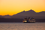 Seattle, WA                               <br /> Washington State ferry on Elliot Bay with Olympic Mts dusk profile