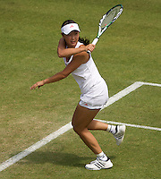 Shuai Peng (CHN) against  Agnieszka Radwanska (POL) (11) in the second round of the ladies singles. Radwanska beat Peng 6-2 6-7 9-7..Tennis - Wimbledon - Day 4 - Thur 25th June 2009 - All England Lawn Tennis Club  - Wimbledon - London - United Kingdom..Frey Images, Barry House, 20-22 Worple Road, London, SW19 4DH.Tel - +44 20 8947 0100.Cell - +44 7843 383 012