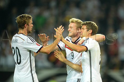 07.09.2014. Dortmund, Germany.   international match Germany Scotland  in Signal Iduna Park in Dortmund. Christoph Kramer, Andre Schurrle  and Thomas Mueller celebrate After the goal to 1-0  from Mueller