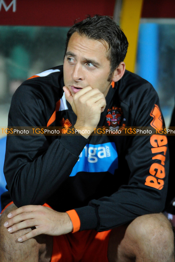 Michael Chopra of Blackpool sits on the bench - Huddersfield Town vs Blackpool - Sky Bet Championship Football at the John Smiths Stadium, Huddersfield, West Yorkshire - 27/09/13 - MANDATORY CREDIT: Greig Bertram/TGSPHOTO - Self billing applies where appropriate - 0845 094 6026 - contact@tgsphoto.co.uk - NO UNPAID USE