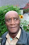 Older man in garden looking worried. MR