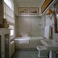 Tiles with a pixelated effect cover the walls and floor of this bathroom